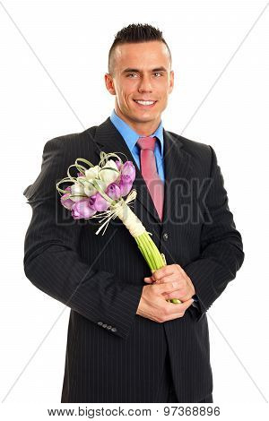 Young man with flowers of tulips