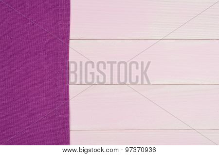 Purple Towel Over Wooden Table