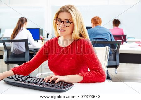 Blond glasses businesswoman working office with computer at desk