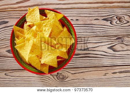 Nachos mexican food tortilla on red white wood background