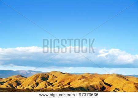 Almeria Tabernas desert mountains in Spain blue sky day