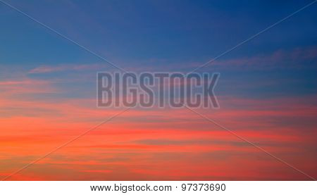 Sunset sky in red orange and blue texture background