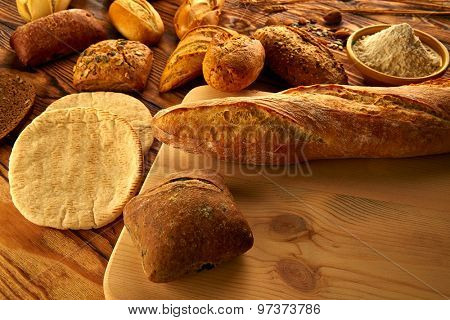Bread fresh varied mix on golden rustic wood golden table