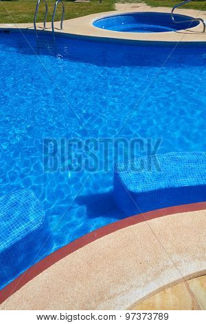 Blue tiles swimming pool water texture background