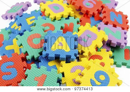 Alphabet and number puzzle pieces