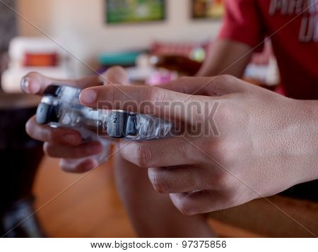 Video Game Console Controller In Gamer Hands. The Kid Play Computer Games Online.