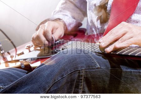 Professional Guitar Player With Electric Guitar Hands Closeup. Studio Environment.