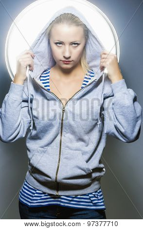 Fashion Concepts. Portrait Of Blond Caucasian Female In Hoody Jacket Standing In Studio Environment
