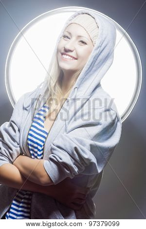 Portrait Of Happy And Laughing Caucasian Blond Woman In Warm Hat And Hoody.