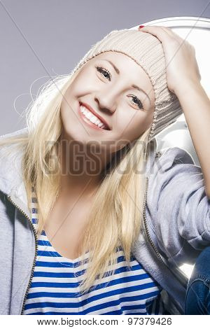 Happy And Positive Young Caucasian Blond Female Against Studio Equipment.
