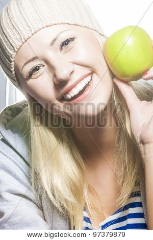 Closeup Portrait Of Smiling Caucasian Woman With Green Apple.