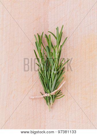Fresh Rosemary Herbal Medicine On Wooden Table