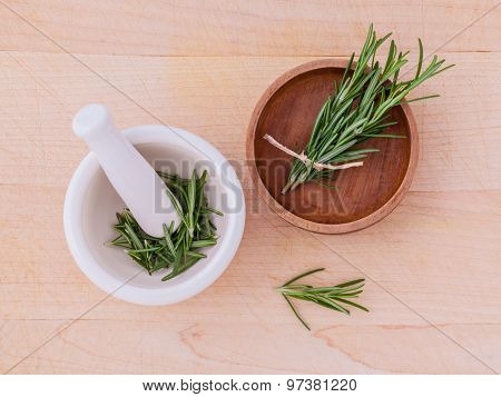 Fresh Rosemary Herbal Medicine In Mortar And Wooden Bowl On Wooden Table