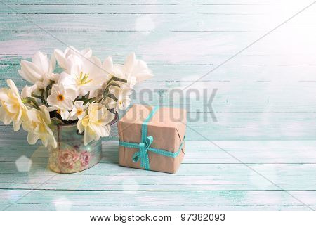 Background With Colorful Narcissus Flowers And Box With Present