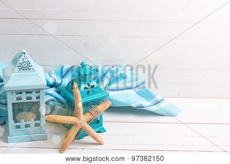 Marine Item, Lanterns  And Blue Towel  O White Wooden Background.