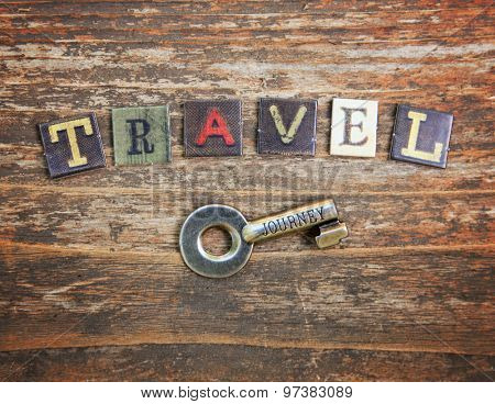 an old vintage background with the word travel over a key that has the word journey etched in it t