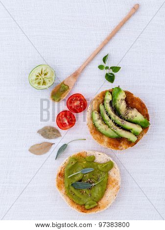 Toast With Avocado Creamy Salad And Herbs  On White Table.
