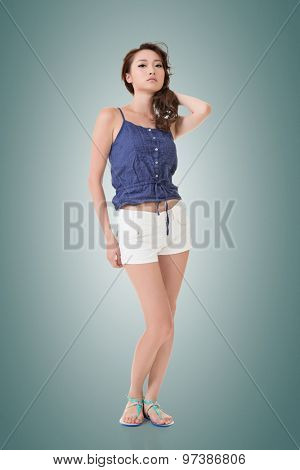 Full length portrait of attractive young pretty asian woman posing to the camera. Isolated on the white background.