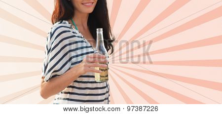 summer holidays, drinks and people concept - close up of smiling young woman drinking from bottle over beige burst rays background