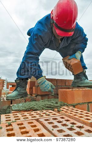 Construction mason worker bricklayer under working
