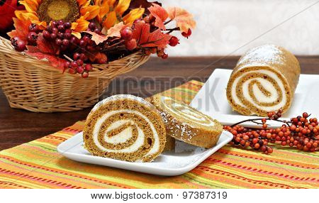 Pumpkin Roll Cake In An Autumn Setting.
