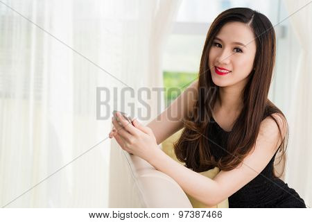 Gorgeous brunette with a smartphone