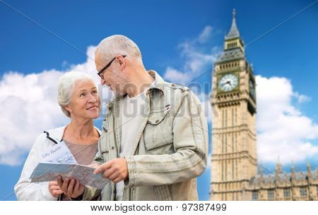 family, age, tourism, travel and people concept - senior couple with map over big ben tower in london city background
