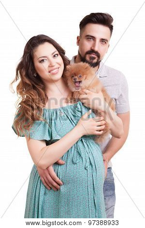 Happy Family With Pregnant Woman And Dog In Hands Smiling Husband