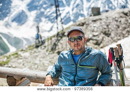 Young Man Mountaineer Sitting On A Mount Cheget