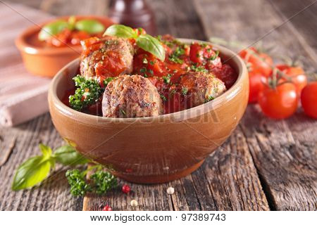 fried meatballs with tomato sauce and herbs