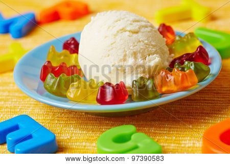 Vanilla ice cream with gummy bears at a children's birthday party