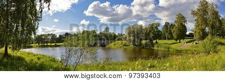 Suburban landscape with a pond and a bridge in Pavlovsk.