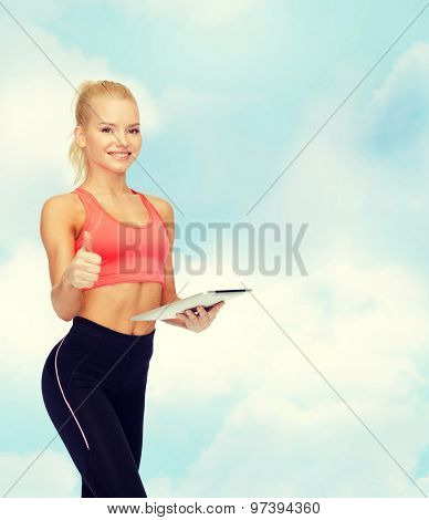 sport, exercise, technology, internet and healthcare - smiling sporty woman with tablet pc computer showing thumbs up