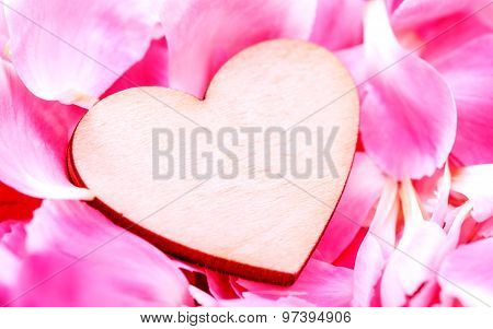 The Wooden Hearts On Pink Carnation Petal.  - Concept For Love And Wedding .