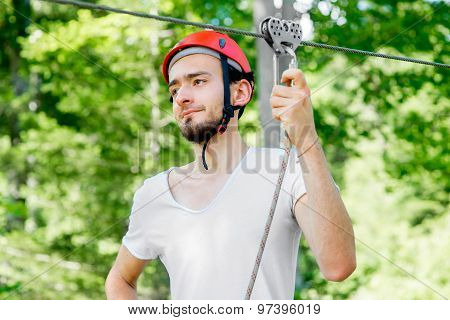 Man riding on a zip line