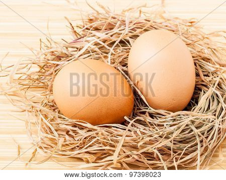 Fresh Of Brown Eggs At Hay Nest .