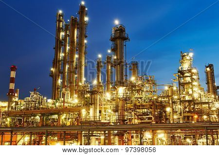 Oil refinery plant of petroleum or petrochemical industry production at sunset