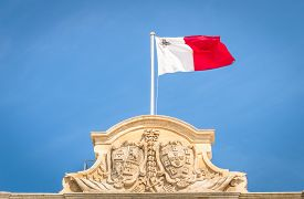 stock photo of maltese  - Maltese white and red flag against a blue sky  - JPG