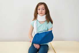 picture of neck brace  - Portrait Of Girl Wearing Neck Brace And Arm Sling - JPG
