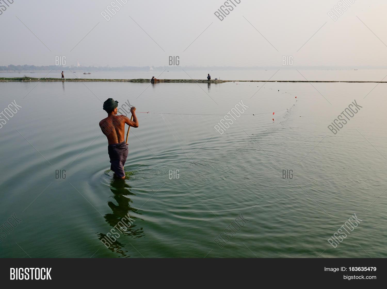 People catching fish on lake image photo bigstock for People catching fish