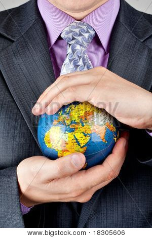 Businessman Carrying World Globe