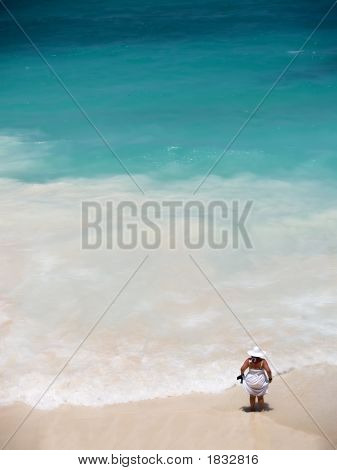 Elegant Woman In White At A Beach
