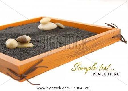 Japanese zen rock garden with black raked sand
