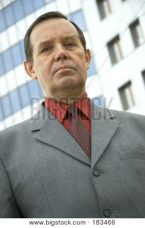 Businessman In Front Of A Building