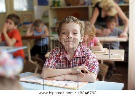Smiling boy in school class