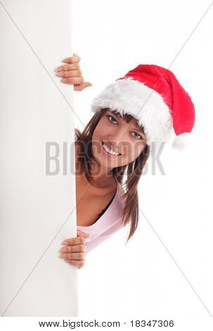 Beautiful woman in Christmas cap and blank in hands isolated on white