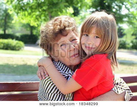Great-granddaughter with great-grandmother embracing