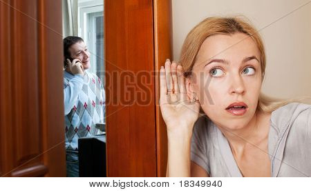 Jealous wife, overhearing a phone conversation her husband