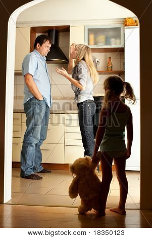 Child looks at the swearing parents