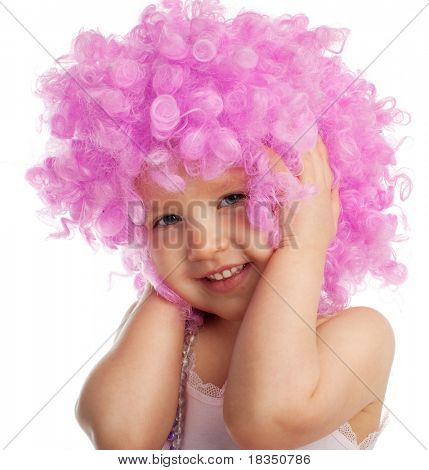 Beautiful little girl in pink wig isolated on white